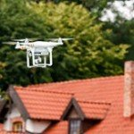 Drone being used in real estate flying above a home